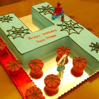 Number 4 Spiderman Cake And Cupcakes Number 4 cake with Gumpaste spiderman and spiderman cupcakes to match