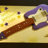Electric Guitar Cake Electric guitar cakeVanilla cake with buttercream and fondant.Strings made from fondant as well.Thanks to all CC members for their help and...