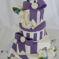 Purple Gifts Last minute wedding cake...fist time with gumpaste roses..