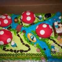 Smurfcake Smurfcake, I used jumbo chocolate cupcakes for the Smurf houses and covered them with my fondant recipe, Smurfs made from gumpaste, poppa...