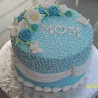 Blue White   Iced in buttercream, royal icing flowers. Gumpaste MOM and butterflies