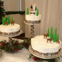 Winter Camo  Buttercream piped snowflakes sprinkled with cake sparkles. The trees are made of fondant. The deer are plastic, sorry not that talented yet...