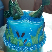 Gavin's Fish This was a cake for my son who loves to go fishing. The fish is made of fondant and brushed with green, brown and a little bit of burgandy...