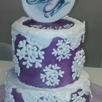 Ice Skating  Buttercream cake, airbrushed purple. The snowflakes are made of royal icing and sprinkled with cake sparkles. The Ice skates on top are an...