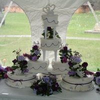 Purple Wedding Buttercream wedding cake with silk flowers.