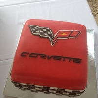 Corvette Groom's Cake Red square fondant covered grooms cake. Corvette logo was made from fondant as well as checker border around bottom of cake.