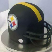 Pittsburgh Steeelers Helmet Birthday cake for a steelers fan. Cake covered in fondant w/fondant accents. The face mask is 50/50 mix. Thanks to Jbramble and Kittikakes...