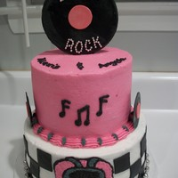 Disco Rock Made this cake for twin girls. Record on top and mini records are Fondant, the bottom border is a disco ball necklace cut to fit. TFL