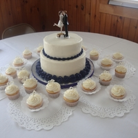 Eggplant Wedding.   Pound cake with buttercream roses. Pound cake cupcakes with white chocolate heart and name toppers.