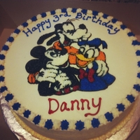 Mickey And Friends Chocolate Chip pound cake with buttercream icing. I used the piping gel transfer technique to apply the characters.