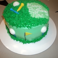 Golf Birthday Cake Chocolate cake with buttercream frosting. Golf balls, flags, and tees made out of MMF.