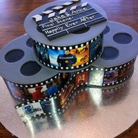 Jake's Cake Film reels for a real-movie buff. Gumpaste disks sandwich a single layer of fondant covered cake. The 'film' was printed at the...