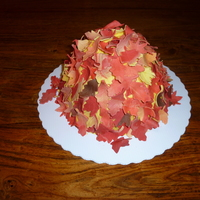 Autumn Leaves For this year's annual Thanksgiving Cake, I simply covered a (wonder-pan baked) cake with gumpaste autumn leaves. Simple and cute.