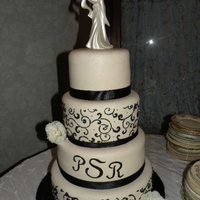"Black And Ivory My very first ""real"" wedding cake! 6, 8, 10, and 12 inch tiers. All WASC with Bavarian cream fill, covered in ivory fondant."