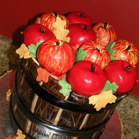 Apple Basket 10 inch x 4 apple spice cake and chocolate cake, covered in BC with fondant basket decoration. All apples are RKT and covered in fondant...