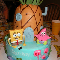 Spongebob All decorations and characters are hand-molded out of fondant. Pineapple shaped cake over a 10 inch base cake.