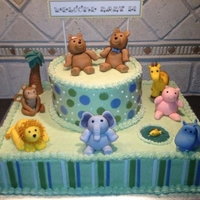 Animal Baby Shower Cake White almond sour cream sheet cake and chocolate layer cake w/buttercream frosting. Fondant decorations.