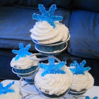 Snowflake Cupcakes White cupcakes with buttercream frosting. The snowflakes are made out of melted Jolly Ranchers.