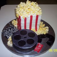 Movie Theater Graduation Cake This is a graduation cake that I made for my cousin's husband. He is a movie fanatic. Everything is edible.The clapboard was supposed...
