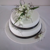 Wedding Cake With Fresh White Singapore Orchids
