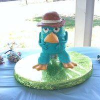 Perry The Platypus Super fun cake that I made for a friend's son. He's a big perry the platypus and Phineas & Ferb fan! Bill, tail & arms...