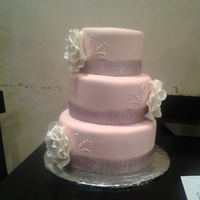 Mauve Fantasy Flower Wedding Cake This is a cake that I did for the NM state fair (its a dummy cake) Mauve/Pink colored fondant, white Gumpaste Fantasy Flowers (my first...