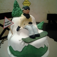 Snowboarder Birthday Cake Made this cake for a friends sisters birthday. Snowboarder is made out of fondant. I was given a pic of her sister snowboarding and made it...