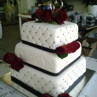 Black And White Square Wedding Cake Bride sent me about 6 pictures of cakes that she liked so we incorporated parts of each cake that she liked and this is what we came up...