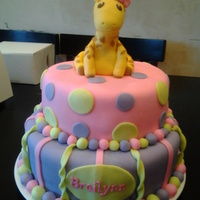 Girly Giraffe First Birthday This was a first bday cake for my neighbors daughter. She wanted something girly and the mom wanted a giraffe because she likes them. So...