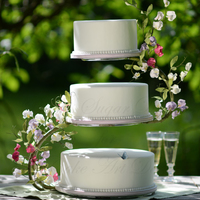 A Midsummer Night Dreams Wedding cake with flowerpaste sweet peas wired to a s-shaped cake stand