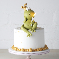 Mr Froggy litte birthday cake with Mr Froggy blowing the candle