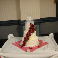 Wedding Cake   White cake with buttercream frosting and redish pink roses