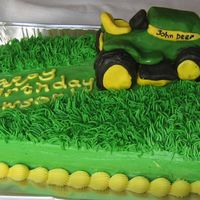 John Deer Mower This is a chocolate cake I made for my nephew who is really into tractors. The mower is made from bought cookies stacked and trimmed to...