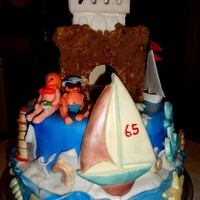 Jimmy's 65Th Nautical Birthday This is a two tier cake. Both tiers are of chocolate marble cake. Filled with chocolate pudding and buttercream apricot filling.all the...