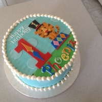 "Circus First Birthday 9"" chocolate with Oreo filling. Fondant decorations to match party decorations."