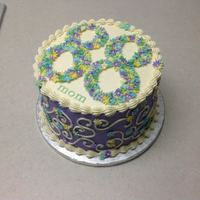 "88Th Blossoms Made for a co-worker's mom. Cake is 8"" chocolate with peanut butter cup filling. Decorations are fondant."