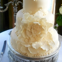 Ivory Fondant Wedding Cake Vanilla Bean cake with vanilla buttercream and Duff's buttercream fondant.