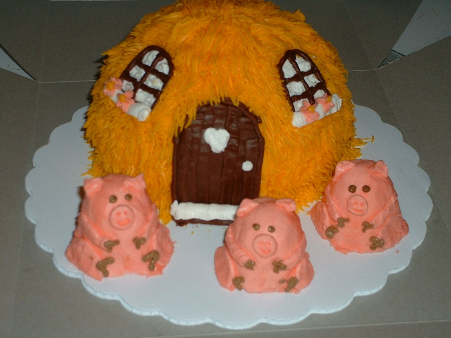 "The 3 Little Pigs I used the soccer ball and 6"" cake pan for house, it is Lemonade Layer cake with the BC icing from Serious_cakes on this site. The..."
