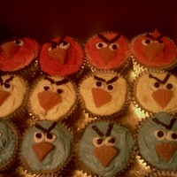 Angry Birds Vanilla cupcakes with colored buttercream, tinted sugars and candy accents.