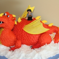 Dragon With Lego Harry Potter  My grandson (age 3) asked for a Lego Harry Potter on a flying orange dragon for his birthday cake. Head, neck, tail and legs are rice...