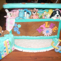 Toy Box Cake Toy box cake with sculpted animals and toys.