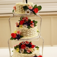 "My Wedding Cake 6"", 8"" and 10"" Italian cream cake with cream cheese basketweave and silk flowers to match the boquet."