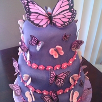 Butterfly Escape chocolate cake filled with kahlua whipped ganache, covered in satin ice fondant and accessorized with fondant and rice paper butterflies. a...