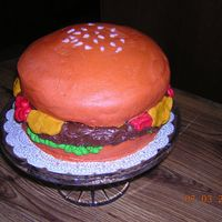 "Hamburger Marble cake, two 8 inch for the ""bun"" and one 9 inch for the ""burger"". All buttercream icing, including ketchup,..."