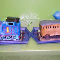 Thomas And Annie Vanilla Annie and Chocolate Thomas the tank engine. Buttercream icing on both. I used the Decopac plastic Thomas accessories. Annie's...