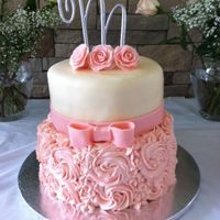 Pink Rosette Cake bottom tier is buttercream rosette, top tier is all fondant, letter was purchased any comments/suggestions are welcomed, thanks for looking...