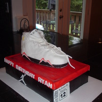 Air Jordan Shoe/shoebox Cake Shoe is molded from Rice Krispy Treats, The box is cake covered in fondant.