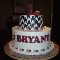 Alabama 1St Birthday Cake 2 tier red velvet cake with buttercream frosting. Houndstooth was done by cutting out cardstock piece and indenting the buttercream and...