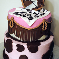 Cowgirl Theme Cake Cake Frosted In Buttercream With Fondant Decorations And A Fondantgumpaste Horse Hand Painted With Food Colors Cowgirl theme cake. Cake frosted in Buttercream with fondant decorations and a fondant/gumpaste horse, hand painted with food colors.