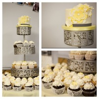 "Cupcake Weddings Mix of different flavor cupcakes with a 6"" cake on top for cutting."